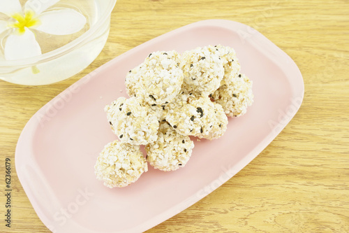 Popped rice mix black sesame  on wood background