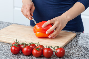 Woman cutting pepper