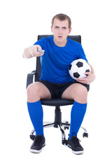 shocked man in uniform with remote control watching soccer game