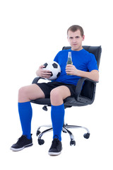 young man in football form sitting with ball and bottle of beer