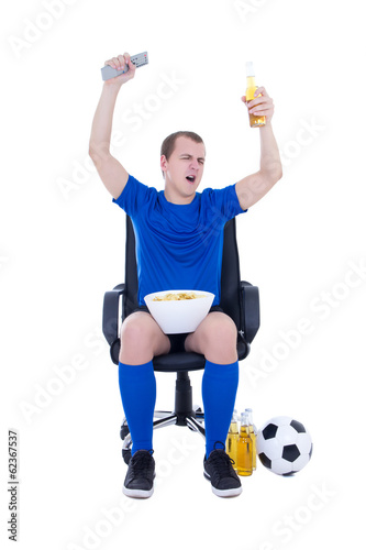 happy man in uniform watching football game and celebrating goal