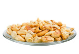 Saucer with roasted cashew nuts isolated on white background