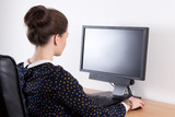back view of young beautiful business woman working in office wi