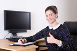 beautiful successful business woman thumbs up in office and pc m