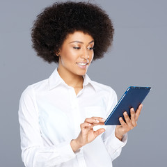 Beautiful African American woman using her tablet