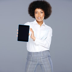 African American woman displaying a tablet-pc