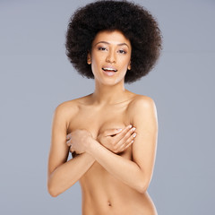 Beautiful nude young woman with an afro hairstyle