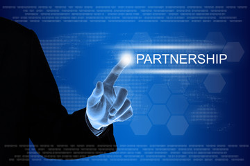 business hand clicking partnership button on touch screen