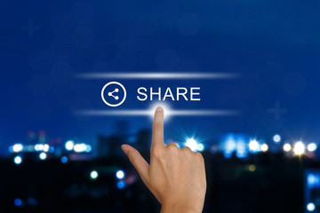 hand pushing share button on touch screen