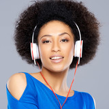 Gorgeous woman listening to music on her earphones