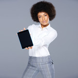 Stylish African American woman showing a tablet