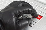 Online spy ware concept with hand wearing black leather glove pr