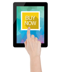 Hand touching a buy now icon on a tablet