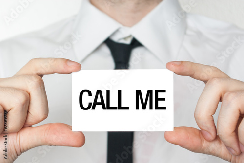 Call me. Businessman in white shirt with a black tie showing or