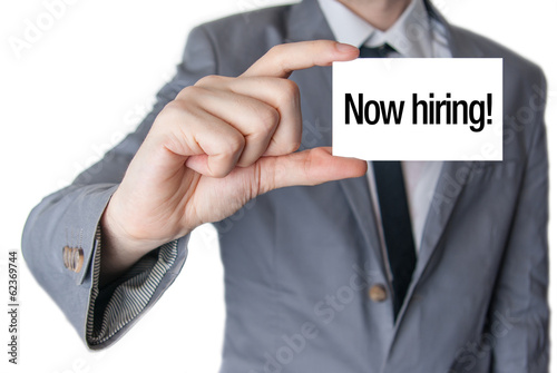 Now hiring advertisement. Businessman in suit with a black tie s