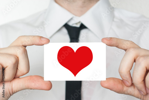 Love. Businessman in white shirt with a black tie showing or hol