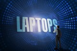 Laptops against futuristic dotted blue and black background