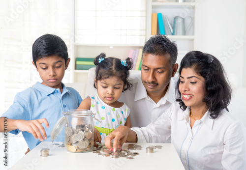 indian family teaching children on savings and financial plannin
