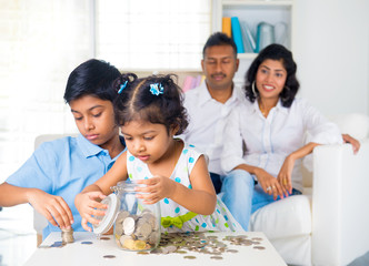 indian parent teaching children on savings and financial plannin