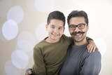 Father and Son over Bokeh Background