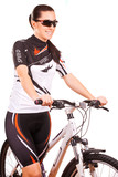 Happy woman cyclist on the bike in studio. isolated