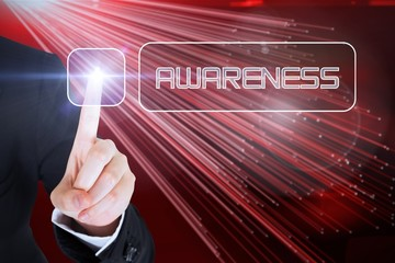 Businesswomans finger touching Awareness button