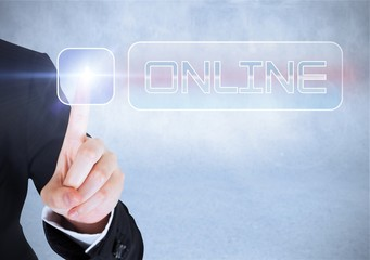 Businesswomans finger touching Online button