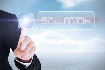 Businesswomans finger touching Solution button