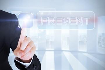 Businesswomans finger touching Prevent button