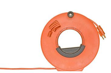 Power cord extension plug on orange plastic reel.
