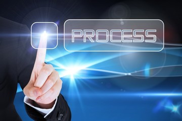 Businesswomans finger touching Process button