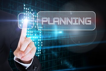 Businesswomans finger touching Planning button