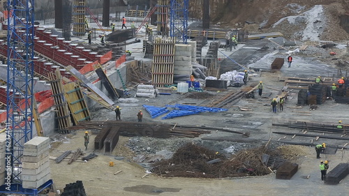 time lapse stadium construction zone with equipment and workers