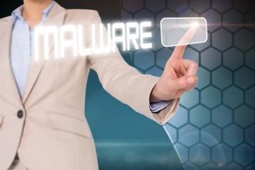 Businesswomans finger touching malware button