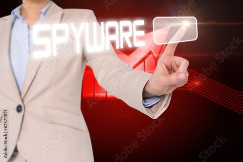 Businesswomans finger touching spyware button