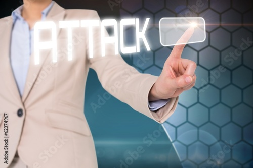 Businesswomans finger touching attack button