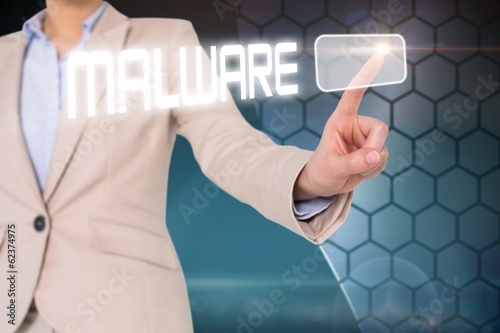Businesswomans finger touching malware button