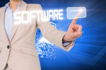 Businesswomans finger touching software button