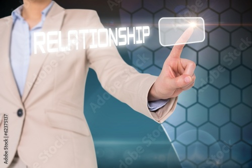 Businesswomans finger touching relationship button