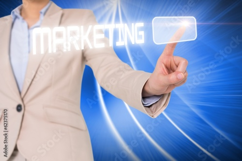 Businesswomans finger touching marketing button