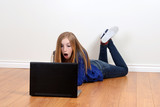 teen girl shocked using laptop