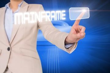 Businesswomans finger touching mainframe button