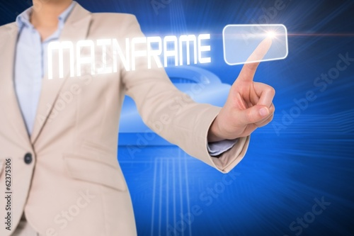 Businesswomans finger touching mainframe button