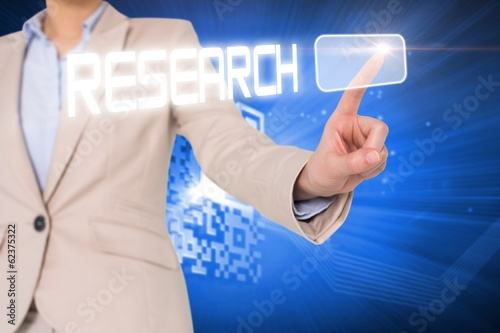 Businesswomans finger touching research button