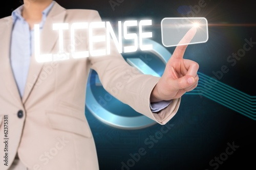 Businesswomans finger touching license button