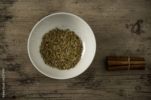 Dried elderberry and cinnamon on wooden table