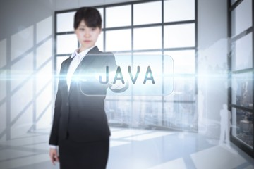 Java against room with large window showing city