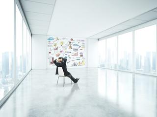 businessman sitting in bright office