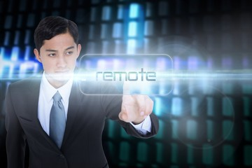 Remote against glowing codes on black background