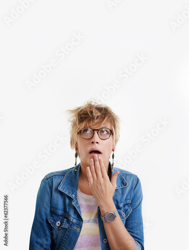 Portrait of shocked young woman
